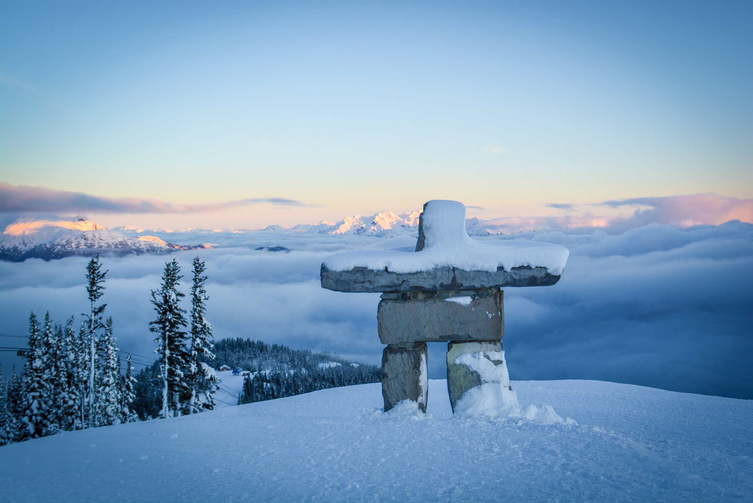 Mountain top inukshuk at sunrise