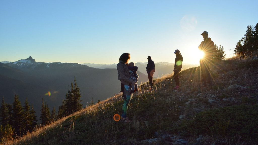 Friends and family on Whistler mountain at sunset.