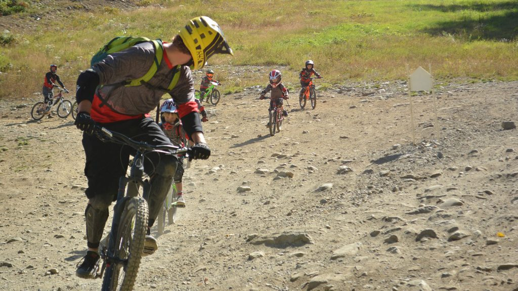 Whistler Mountain bike guide shows young kids the basics of downhill mountain biking.