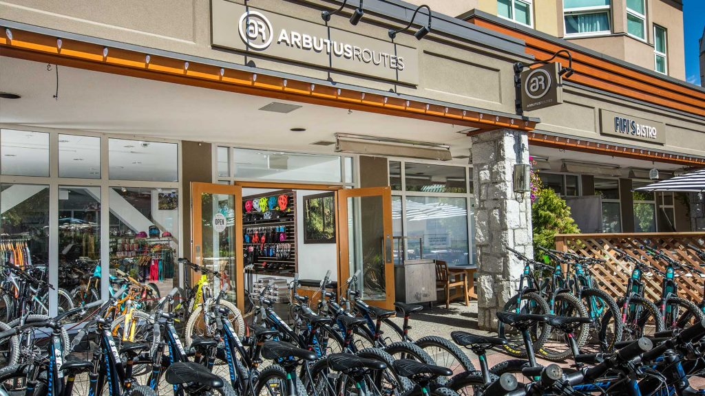 Store front of Arbutus Routes in Whistler Village for mountain bike rentals and guided tours.