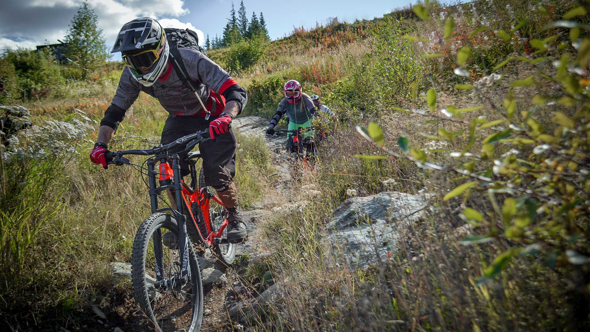 Riders biking down Whistler Mountain Bike Park