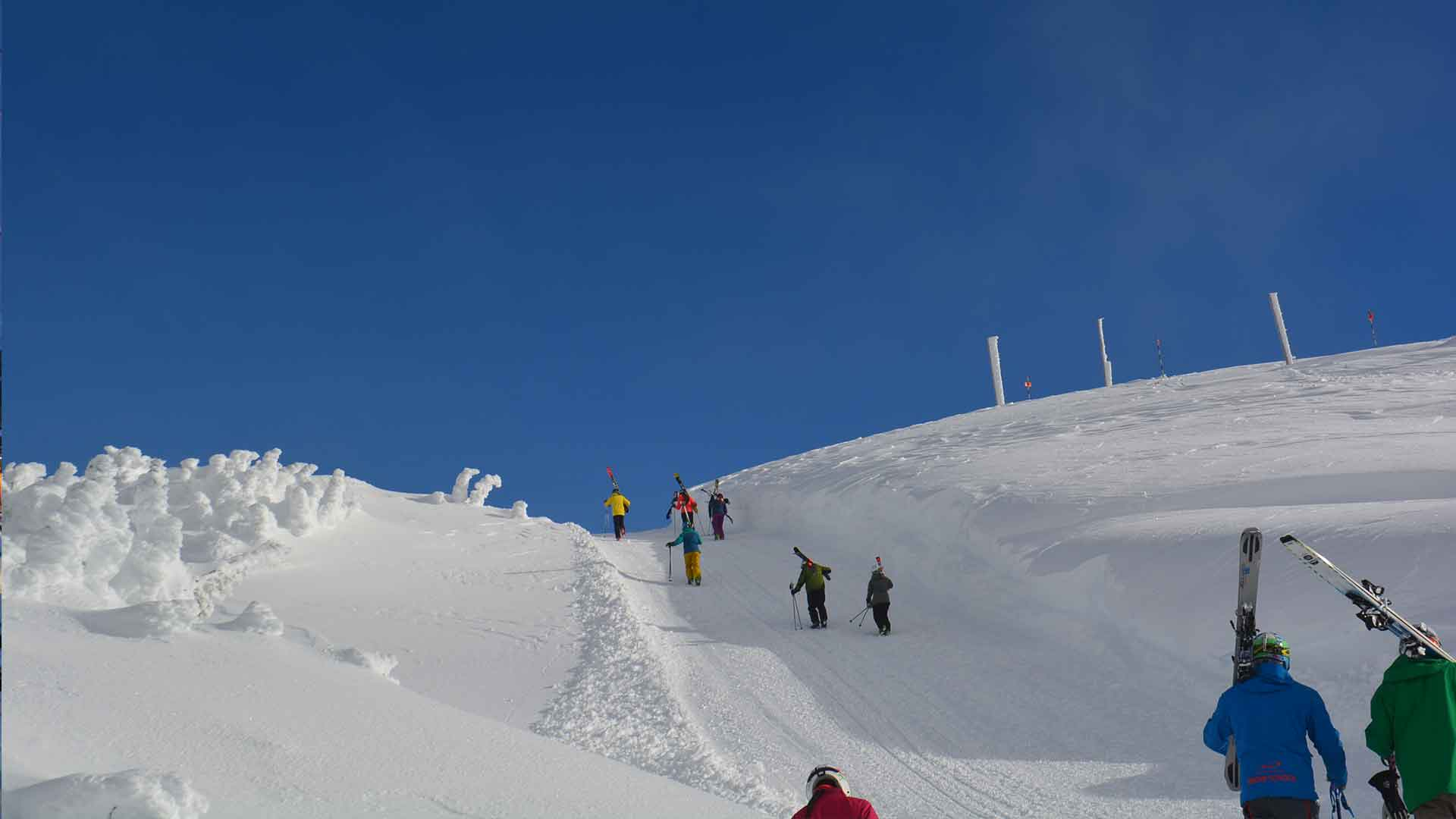 Hiking up with skis to descend Flute Bowl on Whistler Mountain