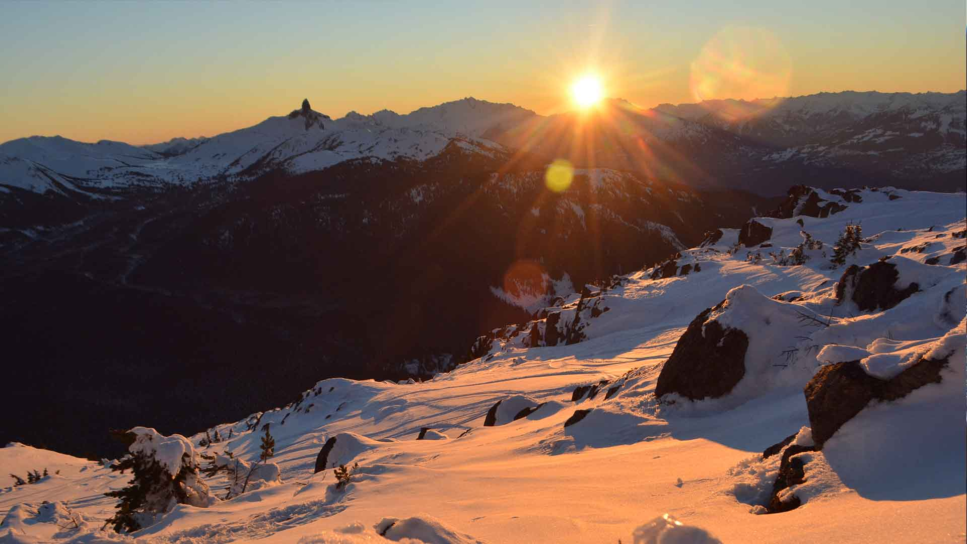 View from Whistler Mountain of the sunset dropping behind the Black Tusk