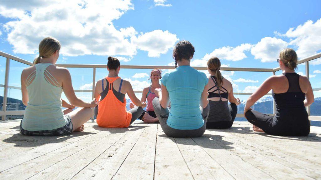 Yogi's enjoying a yoga class on top of Whistler Mountain.
