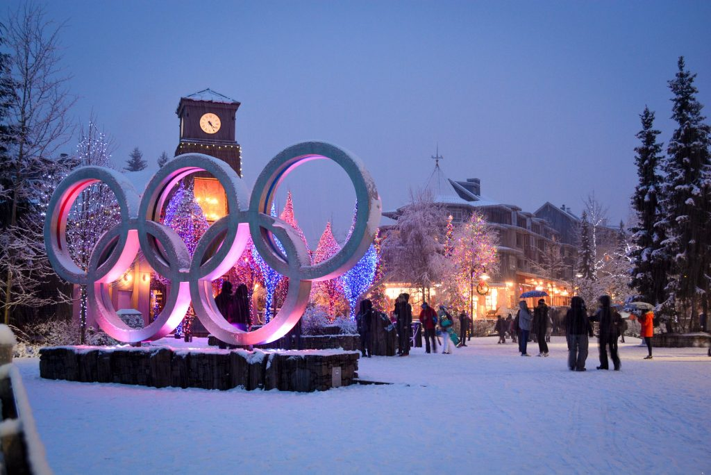 photo of Whistler village at night with the olympic rings lit up