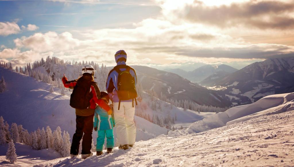 Family skiing in Whistler enjoying the view